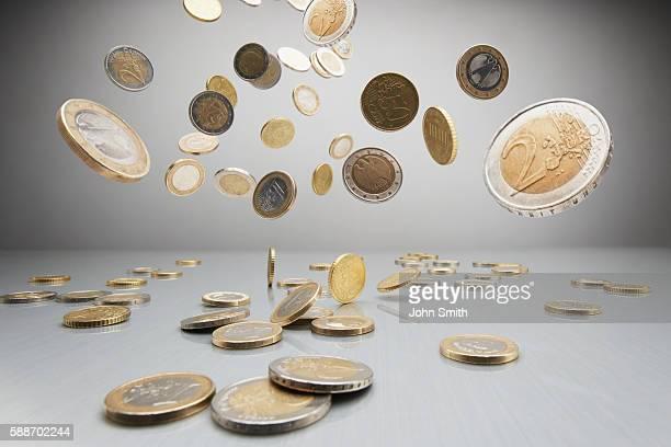 Euro coins falling