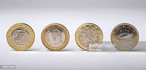 Euro coins from across the euro zone from left to right Greek Spanish Portuguese and Irish sit arranged for a photograph in Madrid Spain on Thursday...