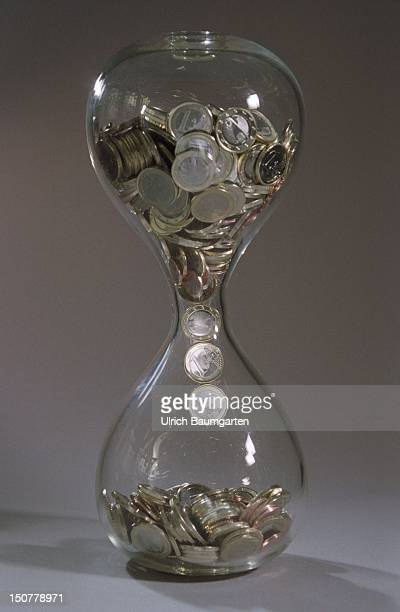 Euro coins in an hourglass