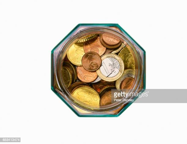 Euro coins in jar close up with copy space
