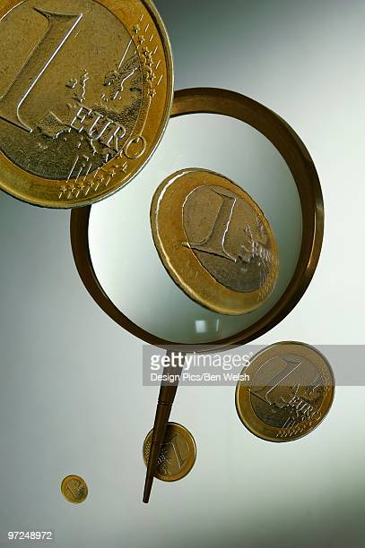 Euro coins magnified and floating
