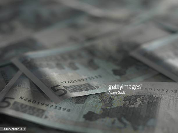 Euro Currency: Loosely piled 5 euro banknotes, close-up
