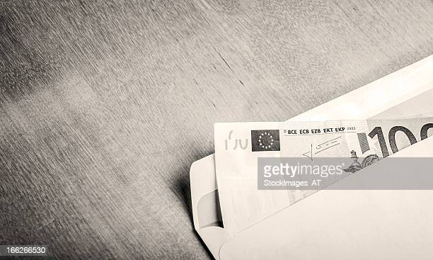 euro currency on oak table vintage photo - corruption stock pictures, royalty-free photos & images