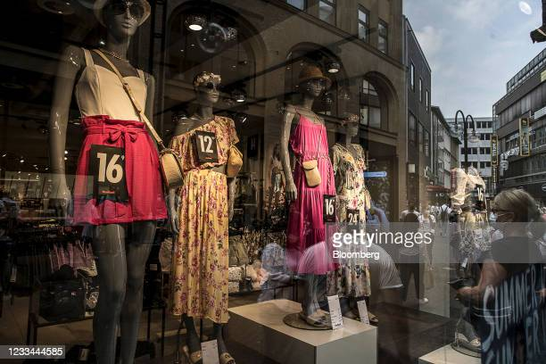 Euro currency price signs on mannequins in a women's clothing store window display in Cologne, Germany, on Saturday, June 12, 2021. German Health...