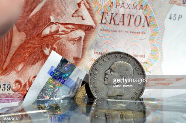 euro drachma - bringing home the bacon stock photos and pictures