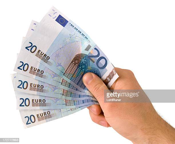 euro in hand - twenty euro banknote stock photos and pictures