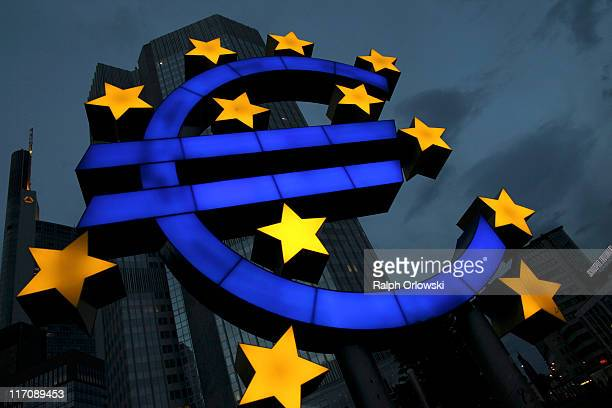 Euro logo stands in front of the headquarters of the European Central Bank on June 21 2011 in Frankfurt am Main Germany Eurozone finance ministers...