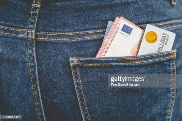 euro money and creditcard for holliday backup in jeans backpocket - finn bjurvoll stock pictures, royalty-free photos & images