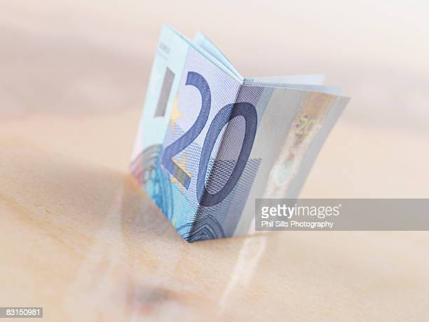 20 euro note, book shaped - twenty euro banknote stock photos and pictures
