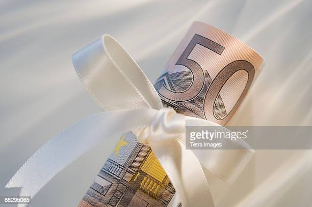 50 euro note wrapped in ribbon