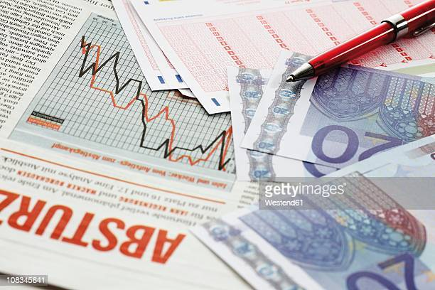euro notes and betting slips on newspaper, close up - monetary policy stock pictures, royalty-free photos & images