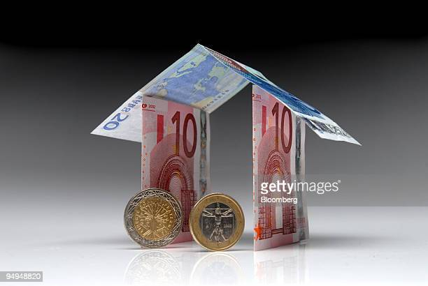 Euro notes and coins form the shape of a house in Paris France on Monday April 27 2009 German Finance Minister Peer Steinbrueck said that the euro...