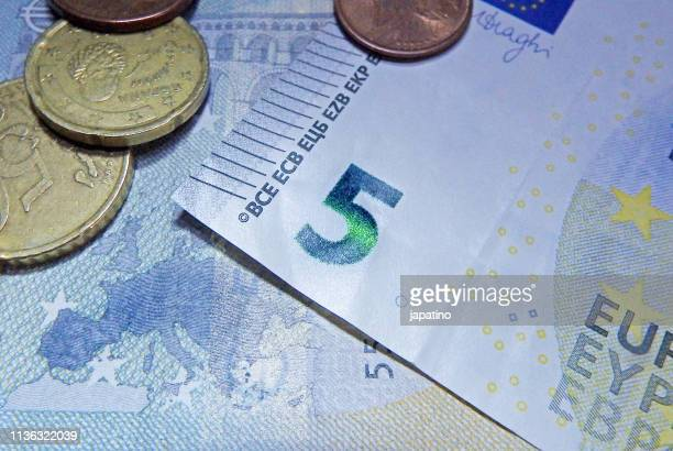 euro notes and coins - five euro banknote stock photos and pictures