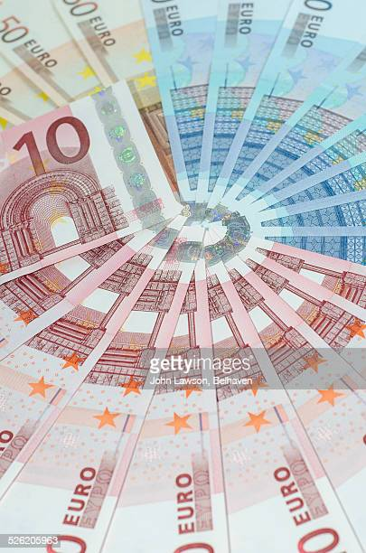 Euro notes arranged in a circular pattern
