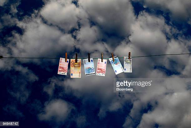 Euro notes hang on a clothesline in Paris France on Monday April 27 2009 German Finance Minister Peer Steinbrueck said that the euro region must and...