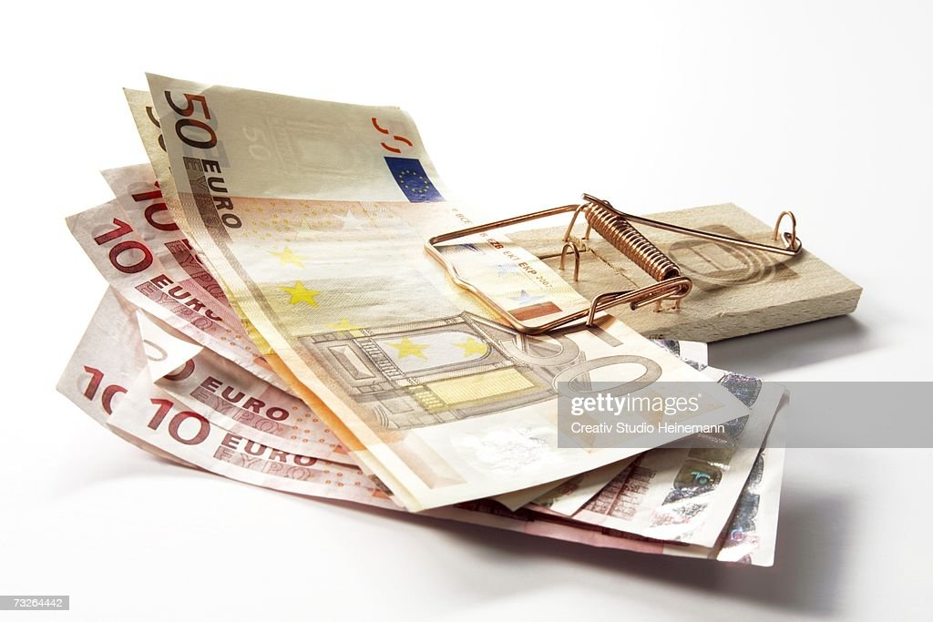 Euro notes in mousetrap, close-up : Stock Photo