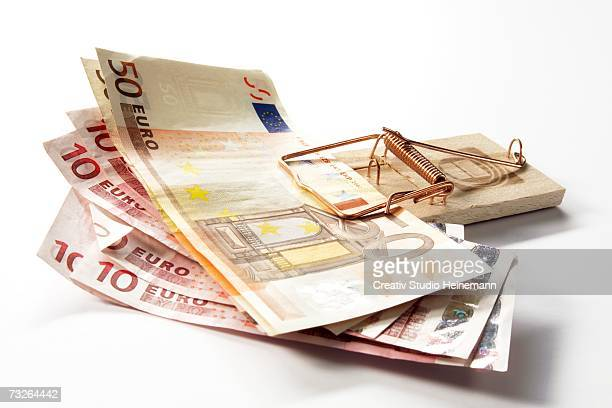 Euro notes in mousetrap, close-up