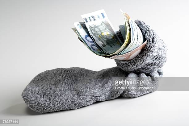 euro notes in stocking - miserly stock pictures, royalty-free photos & images