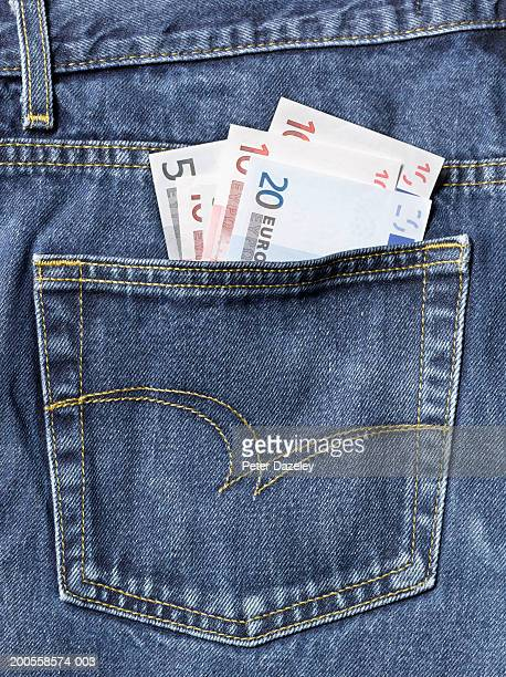 Euro notes sticking out of back pocket of jeans, close-up