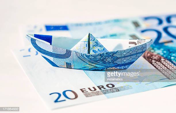 euro paper boat standing on bills - number 20 stock pictures, royalty-free photos & images