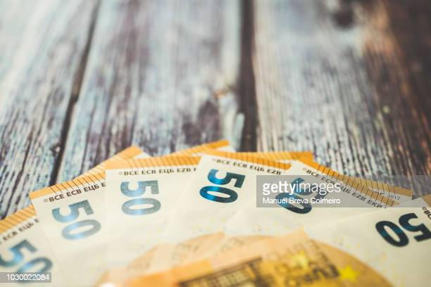euro paper money - euro symbol stock photos and pictures