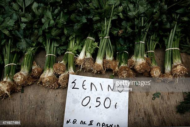 A euro price sign sits beside bundles of celery for sale at a farmer's market on Kassandrou street in Thessaloniki Greece on Thursday May 28 2015...