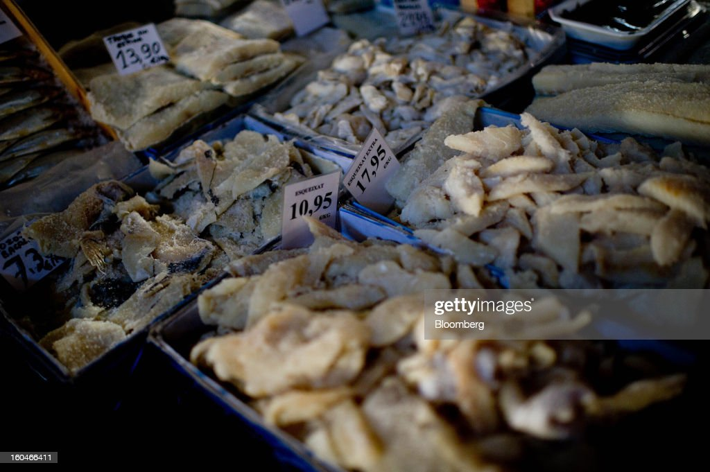 Euro prices stand on a display of dried cod fish at a food stall in the weekly market in Figueres, Spain, on Thursday, Jan. 31, 2013. Spain's recession deepened more than economists forecast in the fourth quarter as the government's struggle to rein in the euro region's second-largest budget deficit weighed on domestic demand. Photographer: David Ramos/Bloomberg via Getty Images