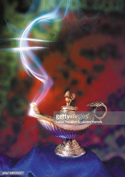 Euro sign in smoke, coming out of oil lamp