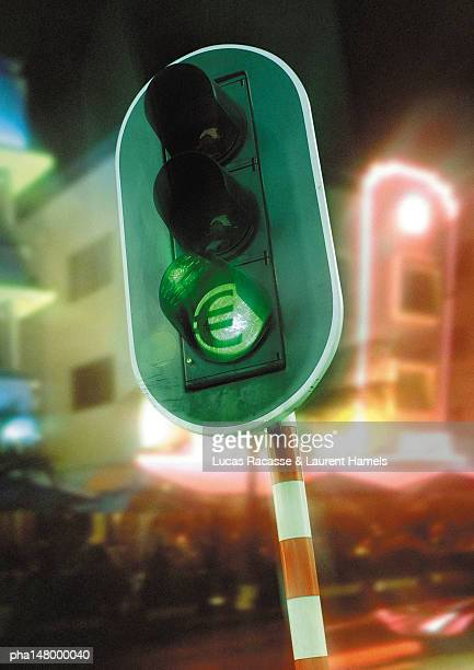 Euro sign on green traffic light.