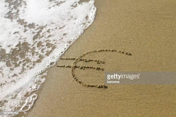 Euro firmare su una spiaggia