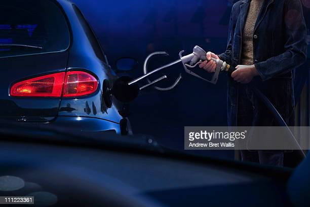 Euro sign petrol pump about to fill vehicle