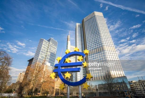 euro symbol in frankfurt - frankfurt main tower stock pictures, royalty-free photos & images
