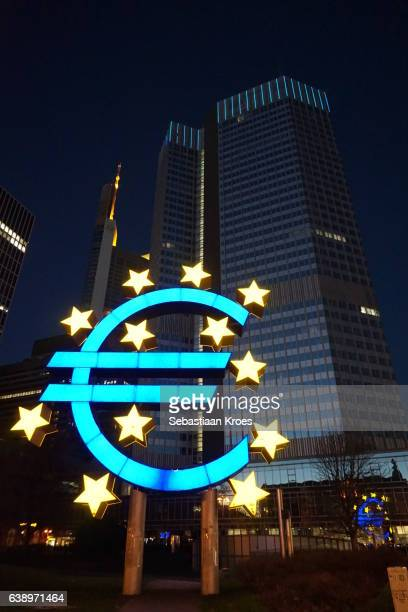 euro symbol sculpture at night, frankfurt, germany - euro symbol stock photos and pictures