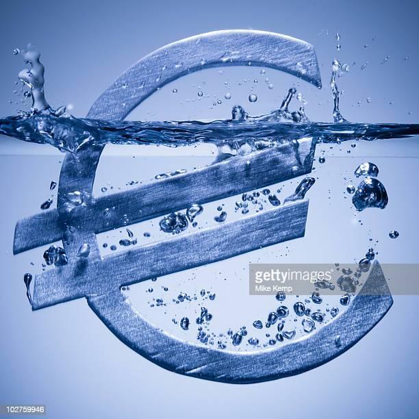 Euro symbol sinking in water