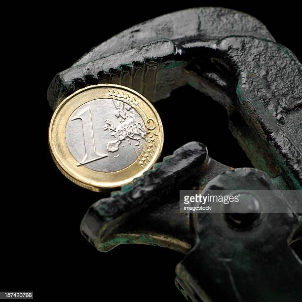euro under pressure - tighten stock photos and pictures