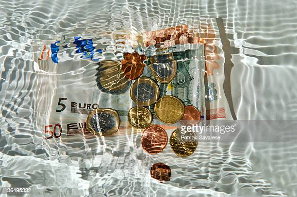 euro underwater - money laundering stock photos and pictures