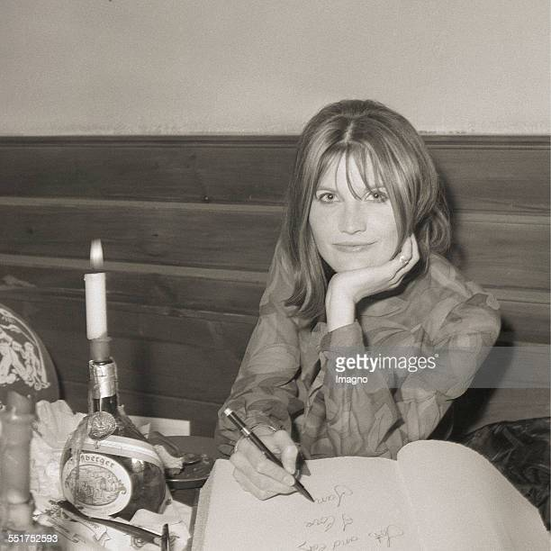 Euro Vision Song Contest 1967 in Vienna The later winner Sandie Shaw entering her name into the guestbook at the Heuriger Vienna April 1967...