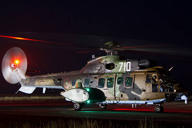 Eurocopter AS-532AL Cougar sits ready for a night flight at Plovdiv Airport, Bulgaria.