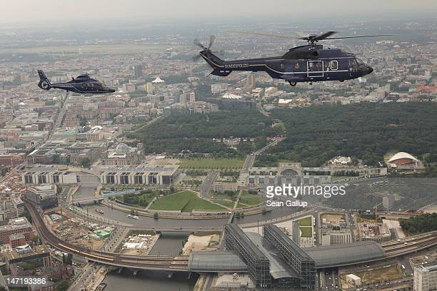 Eurocopter EC 155 and Super Puma AS 332 helicopter of the Bundespolizei the German federal police force fly over the city center as the Reichstag and...