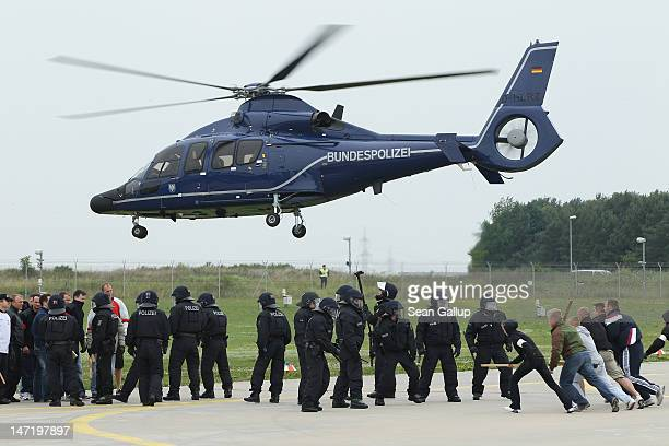 Eurocopter EC 155 helicopter of the Bundespolizei the German federal police force takes off after depositing riot police to break up a mock battle...