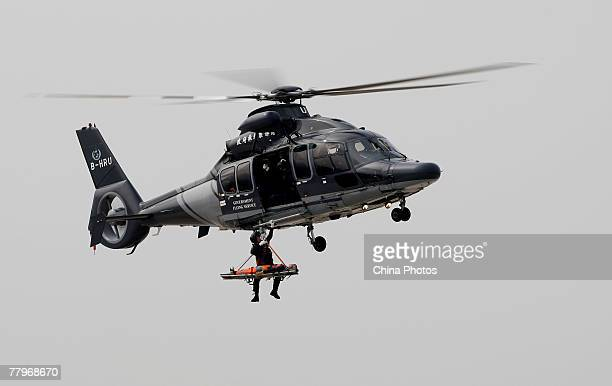 A Eurocopter EC155 B1 Helicopter carries out a rescue mission in a demonstration during the Government Flying Service Open Day on November 18 2007 in...