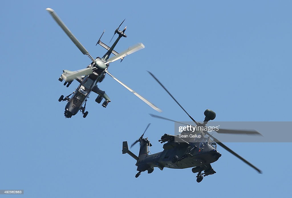 Eurocopter Tiger EC665 military attack helicopters of the French and German air forces fly together at the ILA 2014 Berlin Air Show on May 21, 2014 in Schoenefeld, Germany. The ILA 2014 is open from may 20-25.