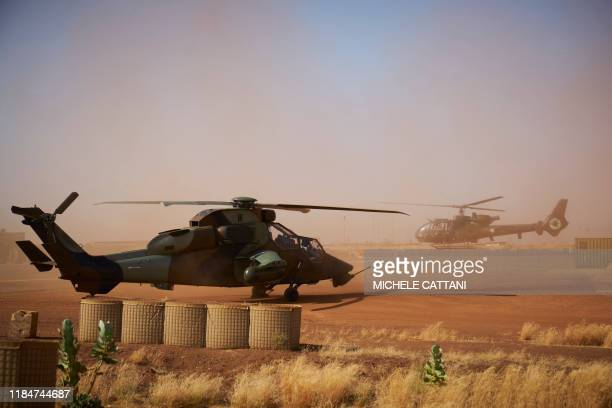A Eurocopter Tiger helicopter is seen at the French Military base in Gao in northern Mali on November 8 2019 Thirteen soldiers from France's...