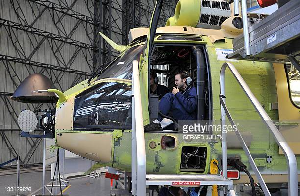 Eurocopter's technicians work on an assembly line of EC225 helicopters dedicated to maintenance and technical support on electrical power lines on...