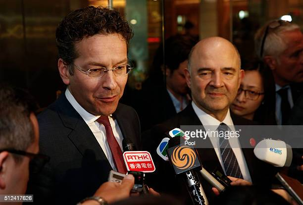 EuroEurogroup President Jeroen Dijsselbloem and EU Economic and Financial Affairs Taxation and Customs Commissioner Pierre Moscovici talk to the...