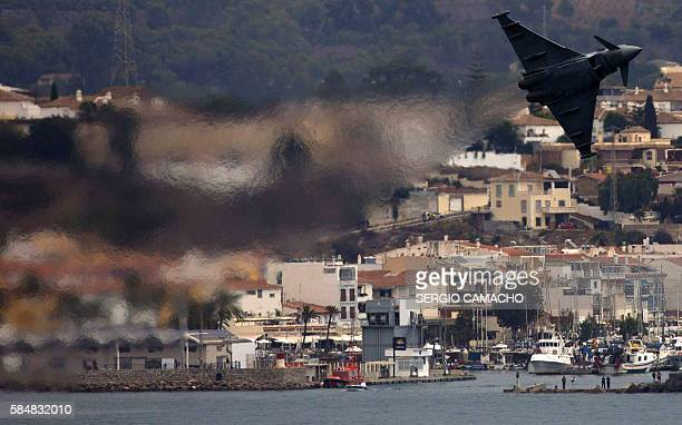 A Eurofighter aircraft performs aerobatics during the Torre del Mar International Air Festival in Torre del Mar near Malaga on July 31 2016 / AFP /...