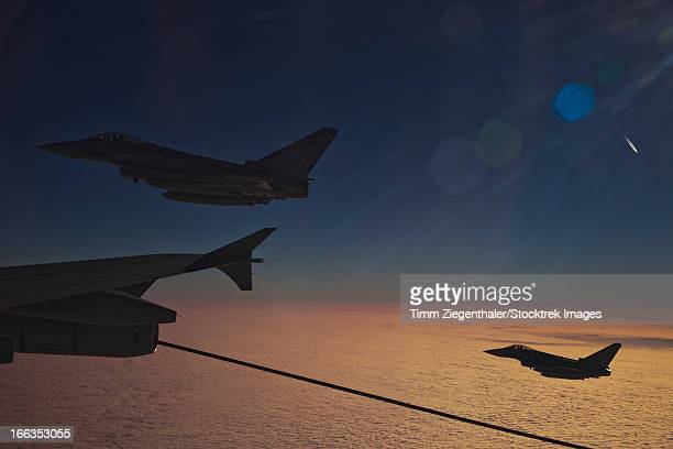 Eurofighter Typhoon aircraft of the German Air Force refueling from an A310 Tanker over France during NATO Exercise Volcanex.