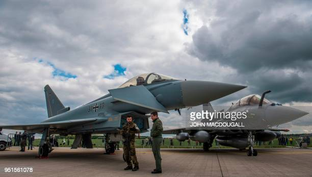 A Eurofighter Typhoon and a Dassault Rafale are seen on the tarmac at the ILA Berlin International Aerospace Exhibition at Schoenefeld airport near...