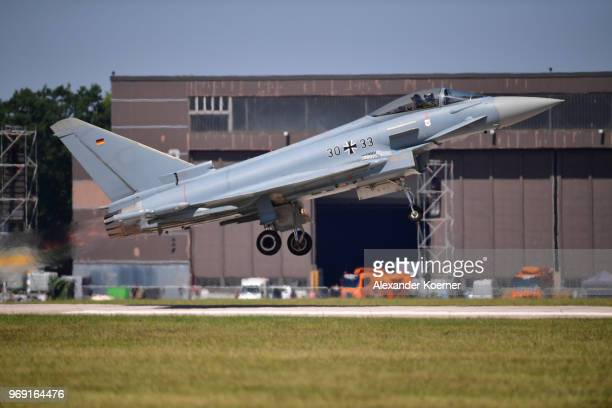 Eurofighter Typhoon jet arrives at Fliegerhorst Wunstorf to take part in an open house day of the Bundeswehr on June 7 2018 in Wunstorf Germany The...