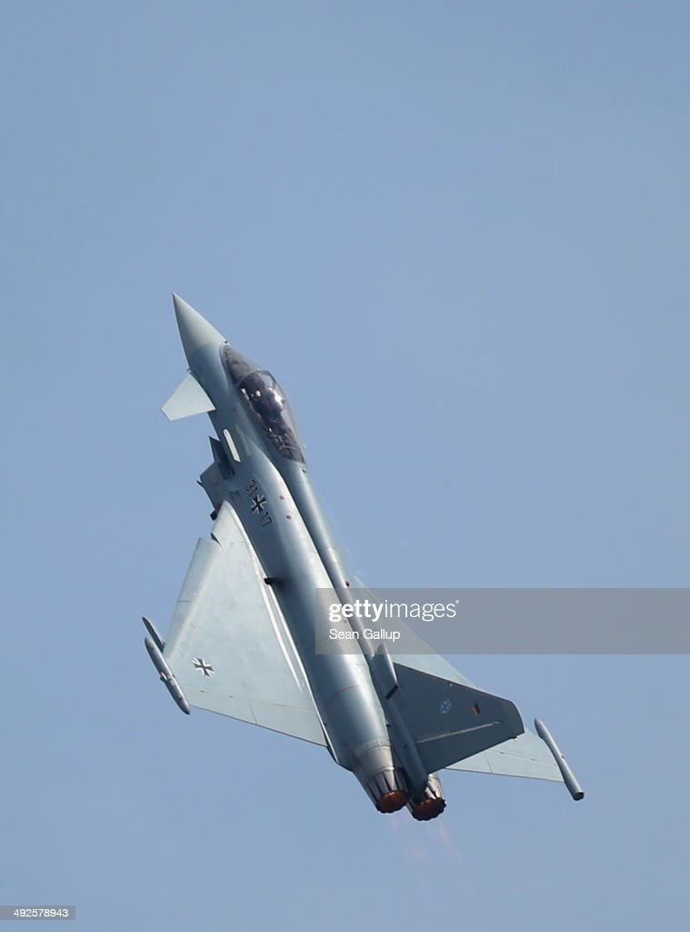 A Eurofighter Typhoon jet fighter flies at the ILA 2014 Berlin Air Show on May 21, 2014 in Schoenefeld, Germany. The ILA 2014 is open from May 20-25.